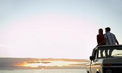 couple on car at beach
